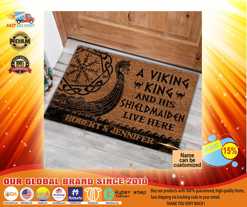 A viking and his shild maiden live here custom name doormat3
